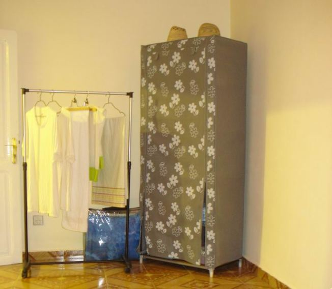 Former Clothing Wardrobe Re-purposed for Linens